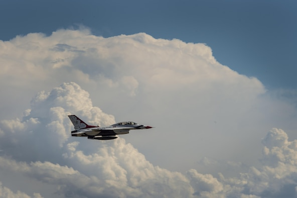 Chancey Williams and Maj. Scott Petz, U.S. Air Force Thunderbirds #8 pilot, soar into the sky during a celebrity flight July 24, 2016, above the Wyoming Air National Guard Base, Cheyenne, Wyo. Williams is an American country music singer-songwriter and a former saddle-bronco rider from Wyoming. (U.S. Air Force photo by Staff Sgt. Christopher Ruano)