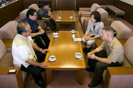 Col. William L. DePue, bottom right, speaks with Masaharu Noguni, bottom left, July 22 in Chatan, Okinawa, Japan. The meeting was part of a courtesy visit to Noguni, the mayor of Chatan town, which is adjacent to Camp Foster and Camp Lester. DePue is the commanding officer of Headquarters and Support Battalion, Marine Corps Installations Pacific-Marine Corps Base Camp Butler, Japan. (U.S. Marine Corps Photo By Cpl. Douglas D. Simons/Released)