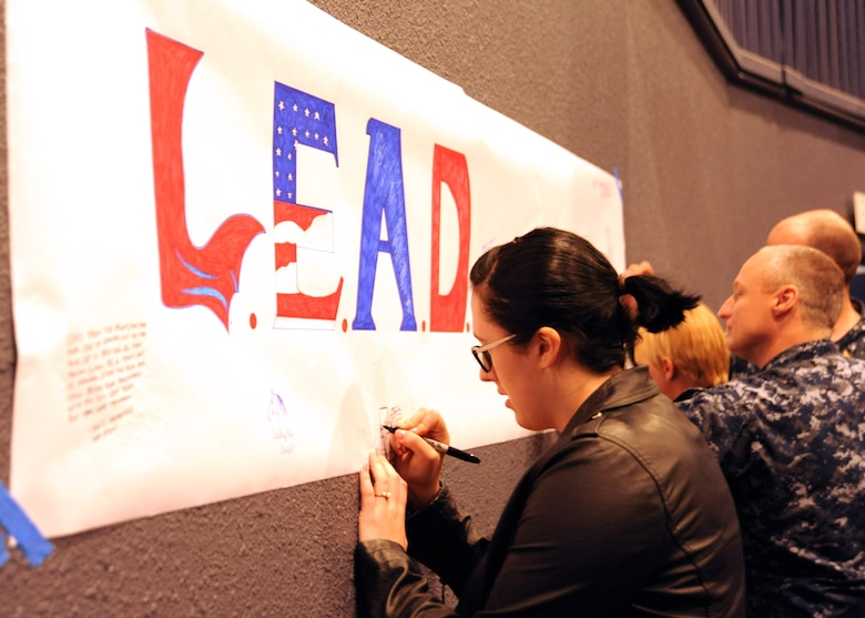 YOKOSUKA, Japan (July 21, 2016)  Cryptologic Technician (Maintenance) 3rd Class Noelle Johnson, assigned to Navy Information Operations Command Yokosuka, draws a picture of what leadership means to her on a poster at 7th Fleet's first Leadership, Equality, and Diversity (LEAD) symposium on Yokosuka Naval Base. The LEAD symposium focused on cultivating leadership and understanding of equality and diversity issues in the Navy. (U.S. Navy photo by Mass Communication Specialist 2nd Class Indra Bosko/Released)