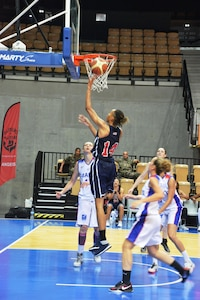 Army Spc. Danielle Salley drives the lane for the layup against French defenders during the bronze medal match of the 1st CISM World Women's Military Basketball Championship held in Angers, France from 28 June to 5 July 2015.  USA defeated France 78-41 to take the bronze.