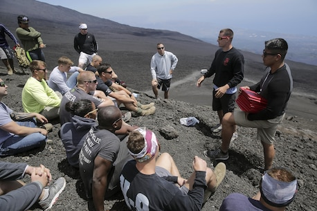 Staff Sgt. Michael Reinert, a martial arts instructor with Special Purpose Marine Air-Ground Task Force Crisis Response-Africa, shares some motivating words for the graduating class of 182-16 Marine Corps Martial Arts Instructors course after they reached the top of Mt. Etna, an active volcano in Sicily, for their graduation, July 21, 2016.  The four-week long MAI course included intense hand-to-hand combat, physical training, and classes on additional techniques and warrior ethos.  (U.S. Marine Corps photo by Cpl. Alexander Mitchell/released)