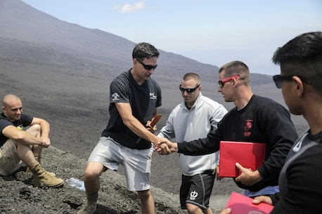 Sgt. Joshua Steinbeiser, a floor chief in maintenance with Special Purpose Marine Air-Ground Task Force Crisis Response-Africa, receives the honor graduate award on top of Mt. Etna, an active volcano in Sicily, during their graduation, July 21, 2016.  The four-week long MAI course included intense hand-to-hand combat, physical training, and classes on additional techniques and warrior ethos.  (U.S. Marine Corps photo by Cpl. Alexander Mitchell/released)