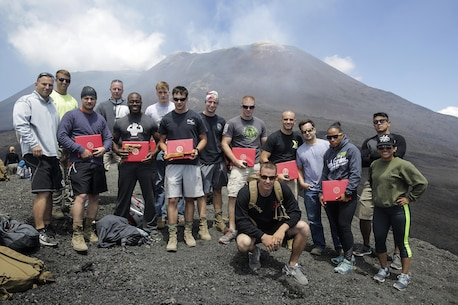 Eleven Marines with Special Purpose Marine Air-Ground Task Force Crisis Response-Africa, pose for a group photo the graduating class of 182-16 Marine Corps Martial Arts Instructors course on top of Mt. Etna, an active volcano in Sicily, July 21, 2016.  The four-week long MAI course included intense hand-to-hand combat, physical training, and classes on additional techniques and warrior ethos.  (U.S. Marine Corps photo by Cpl. Alexander Mitchell/released)
