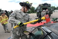 Air Force Staff Sgt. Michael Frye removes a car windshield with an axe during vehicle extrication training as part of Patriot North 16 at Volk Field, Wisc., July 16, 2016. Frye is a firefighter assigned to the West Virginia Air National Guard's 167th Civil Engineer Squadron. Patriot North is an annual exercise to test the National Guard's capabilities and develop working relationships with first responders and government agencies. Air National Guard photo by Senior Master Sgt. David H. Lipp