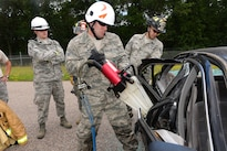 Air Force Senior Airman Hassen Drissi prepares to practice using hydraulic tools during vehicle extrication training as part of Patriot North 16 at Volk Field, Wis., July 16, 2016. Drissi is a firefighter assigned to the Illinois Air National Guard's 182nd Civil Engineer Squadron. Air National Guard photo by Senior Master Sgt. David H. Lipp