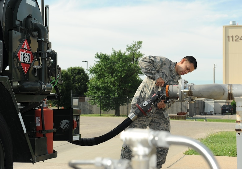 Airman 1st Class Jose Arredondo, 22nd Logistics Readiness Squadron petroleum, oils and lubricants apprentice, connects a fuel hose to a hydrant, July 19, 2016, at McConnell Air Force Base, Kan. This test needs to be done daily to ensure the fuel being transferred to KC-135 Stratotanker aircraft is clean and serviceable. (U.S. Air Force photo/Senior Airman David Bernal Del Agua)