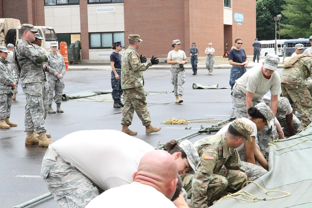 Capt. Burke Tervort, with the 48th Combat Support Hospital out of Fort Meade, Md., gives commands to service members in order to set up the veterinary hospital tents in preparation for the Healthy Cortland Innovative Readiness Training event, July 14th, 2016.  Healthy Cortland is one of the IRT events that provides real-world training in a joint civil-military environment while delivering world-class medical care to the people of Cortland County, N.Y., from July 15-24.