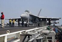 An F/A-18E Super Hornet prepares to launch from the aircraft carrier USS Dwight D. Eisenhower in the Arabian Gulf, July 22, 2016. The carrier and its strike group are deployed in support of Operation Inherent Resolve in the U.S. 5th Fleet area of operations. Navy photo by Mass Communication Specialist 3rd Class Bobby Baldock