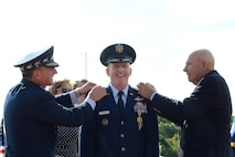 Air Force Chief of Staff Gen. David L. Goldfein and retired Army Col. Joe Wilson pin stars onto the uniform of Air Force Gen. Stephen W. Wilson, the U.S. Strategic Command deputy commander, during his promotion to general at Offutt Air Force Base, Neb., July 22, 2016. Goldfein, who presided over the ceremony, said that Wilson had the competence and character required to be promoted to the rank of general and hold the position of 39th vice chief of staff of the Air Force. (U.S. Air Force photo/Master Sgt. April Wickes)