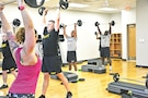 Soldiers participate in the Body Pump class at Whitside Fitness Center July 11 as part of unit physical training.