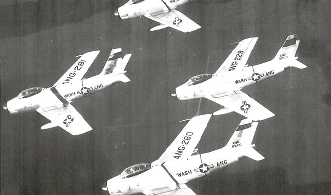 Four Washington National Guard F-86 Sabres in formation. In 1950, the 116th Fighter-Interceptor Squadron was the first guard unit west of the Mississippi River equipped with jets. (Courtesy Photo)