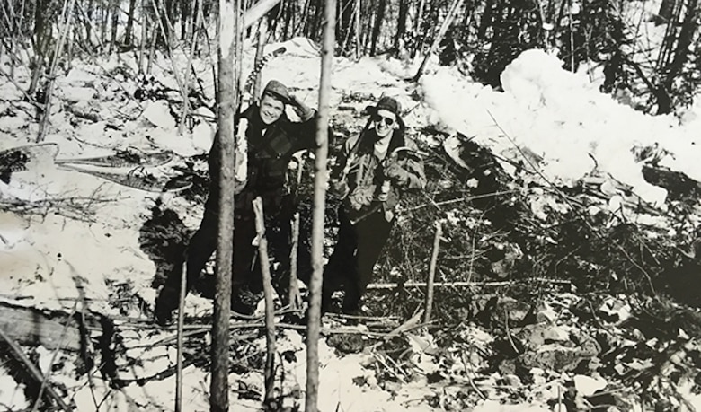 Lt. Hal Morrill poses with Lt. Dallas Sartz within the impact crater of the F-86 Sabre crash, days after the crash. Due to the terrain of the crash site, the Washington National Guard was never able to remove the wreckage. (Courtesy Photo)