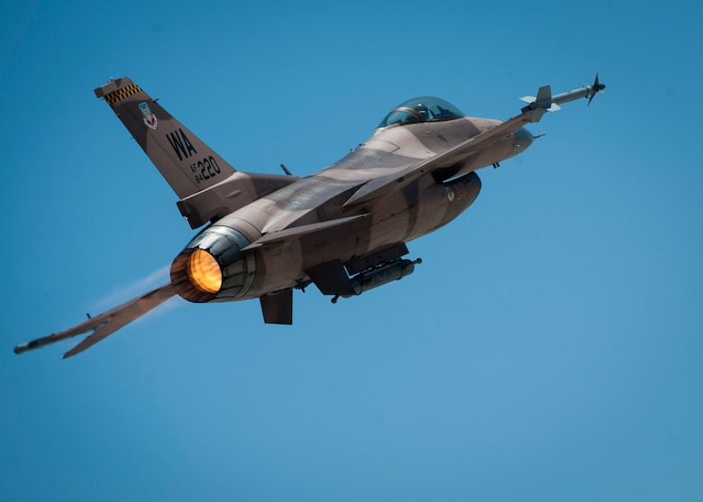 "An F-16C from the 64th Aggressors Squadron, Nellis Air Force Base, Nev., banks off towards the Nevada Test and Training Range to participate in a training sortie during Red Flag 16-3, July 19, 2016. During Red Flag, the 64th AGRS will test other unit's capabilities in air-to-air combat while acting as the ""enemy"" in the exercise. (U.S. Air Force photo by Senior Airman Jake Carter/Released)"