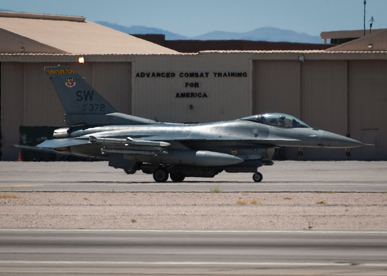 An F-16CJ from the 20th Fighter Wing, Shaw Air Force Base, S.C., taxis down the Nellis Air Force Base, Nev., flightline in preparation for take-off during Red Flag 16-3, July 19, 2016. For Red Flag 16-3, units from the Air Force, Marine Corps and Navy will integrate together to defeat their adversaries while working with air, space and cyberspace counterparts. (U.S. Air Force photo by Senior Airman Jake Carter)