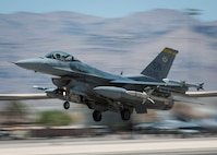 An F-16CJ from the 20th Fighter Wing, Shaw Air Force Base, S.C., takes off from the Nellis Air Force Base, Nev., flightline to participate in Red Flag 16-3, July 19, 2016. Red Flag, which is conducted by the 414th Combat Training Squadron at Nellis AFB, is a realistic combat training exercise involving the air forces of the U.S. and its allies that maximizes the combat readiness and survivability of participants by providing a realistic training environment. (U.S. Air Force photo by Senior Airman Jake Carter/Released)