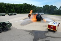 National Guard members spray water onto a mock aircraft fire during exercise Patriot North 16 at Volk Field, Wis., July 17, 2016. Air National Guard photo by Senior Master Sgt. David H. Lipp