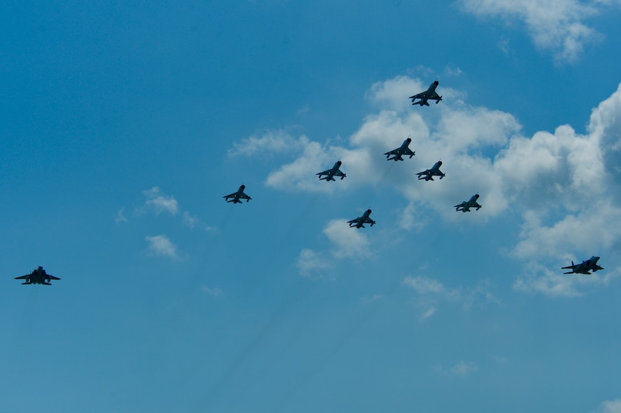 A flight formation of Romanian air force MiG-21 LanceR aircraft and U.S. Air Force F-15C Eagle fighter aircraft fly during the RoAF's 71st Air Base's air show and open house at Campia Turzii, Romania, July 23, 2016.  The aviation demonstration took place during the middle of the U.S. Air Force's 194th Expeditionary Fighter Squadron's six-month long theater security package deployment to Europe in support of Operation Atlantic Resolve, which aims to bolster the U.S.'s continued commitment to the collective security of NATO and dedication to the enduring peace and stability in the region. The unit, comprised of more than 200 CANG Airmen from the 144th Fighter Wing at Fresno ANG Base, California, as well as U.S. Air Force Airmen from the 52nd Fighter Wing at Spangdahlem Air Base, Germany, piloted, maintained and supported the deployment of 12 F-15Cs Eagle fighter aircraft throughout nations like Romania, Iceland, the United Kingdom, the Netherlands, Estonia and among others. The F-15Cs took to the skies alongside the 71st AB's MiG-21 fighter aircraft and Puma helicopters for both the airshow, the second engagement of its kind at Campia Turzii under Operation Atlantic Resolve, and the bilateral flight training, also known as Dacian Eagle 2016. (U.S. Air Force photo by Staff Sgt. Joe W. McFadden/Released)