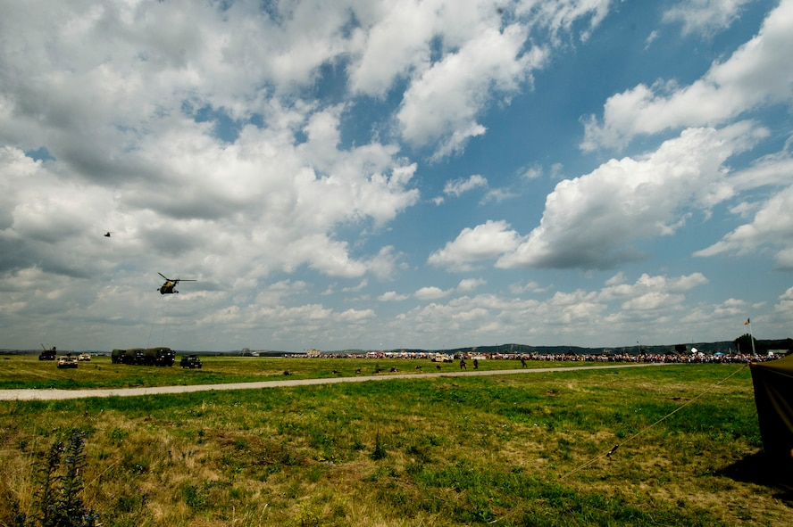 Romanian armed forces helicopters, soldiers, tanks and vehicles participate in a simulated combat and rescue scenario during the Romanian air force's 71st Air Base's air show and open house at Campia Turzii, Romania, July 23, 2016. The aviation demonstration took place during the middle of the U.S. Air Force's 194th Expeditionary Fighter Squadron's six-month long theater security package deployment to Europe in support of Operation Atlantic Resolve, which aims to bolster the U.S.'s continued commitment to the collective security of NATO and dedication to the enduring peace and stability in the region. The unit, comprised of more than 200 CANG Airmen from the 144th Fighter Wing at Fresno ANG Base, Calif., as well as U.S. Air Force Airmen from the 52nd Fighter Wing at Spangdahlem Air Base, Germany, piloted, maintained and supported the deployment of 12 F-15Cs Eagle fighter aircraft throughout nations like Romania, Iceland, the United Kingdom, the Netherlands, Estonia and among others. The F-15Cs took to the skies alongside the 71st AB's MiG-21 fighter aircraft and Puma helicopters for both the airshow, the second engagement of its kind at Campia Turzii under Operation Atlantic Resolve, and the bilateral flight training, also known as Dacian Eagle 2016. (U.S. Air Force photo by Staff Sgt. Joe W. McFadden/Released)