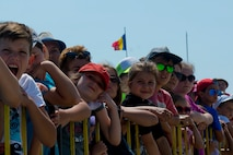 Romanian children watch aircraft take off from the flightline during the Romanian air force's 71st Air Base's air show and open house at Campia Turzii, Romania, July 23, 2016. The aviation demonstration took place during the middle of the U.S. Air Force's 194th Expeditionary Fighter Squadron's six-month long theater security package deployment to Europe in support of Operation Atlantic Resolve, which aims to bolster the U.S.'s continued commitment to the collective security of NATO and dedication to the enduring peace and stability in the region. The unit, comprised of more than 200 CANG Airmen from the 144th Fighter Wing at Fresno ANG Base, Calif., as well as U.S. Air Force Airmen from the 52nd Fighter Wing at Spangdahlem Air Base, Germany, piloted, maintained and supported the deployment of 12 F-15Cs Eagle fighter aircraft throughout nations like Romania, Iceland, the United Kingdom, the Netherlands, Estonia and among others. The F-15Cs took to the skies alongside the 71st AB's MiG-21 fighter aircraft and Puma helicopters for both the airshow, the second engagement of its kind at Campia Turzii under Operation Atlantic Resolve, and the bilateral flight training, also known as Dacian Eagle 2016. (U.S. Air Force photo by Staff Sgt. Joe W. McFadden/Released)