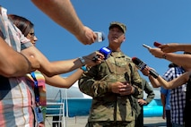 California Army National Guard Maj. Gen. Matthew Beevers, deputy adjutant general of the California Military Department, smiles answers reporters' questions during the Romanian air force's 71st Air Base's air show and open house at Campia Turzii, Romania, July 23, 2016. The aviation demonstration took place during the middle of the U.S. Air Force's 194th Expeditionary Fighter Squadron's six-month long theater security package deployment to Europe in support of Operation Atlantic Resolve, which aims to bolster the U.S.'s continued commitment to the collective security of NATO and dedication to the enduring peace and stability in the region. The unit, comprised of more than 200 CANG Airmen from the 144th Fighter Wing at Fresno ANG Base, Calif., as well as U.S. Air Force Airmen from the 52nd Fighter Wing at Spangdahlem Air Base, Germany, piloted, maintained and supported the deployment of 12 F-15Cs Eagle fighter aircraft throughout nations like Romania, Iceland, the United Kingdom, the Netherlands, Estonia and among others. The F-15Cs took to the skies alongside the 71st AB's MiG-21 fighter aircraft and Puma helicopters for both the airshow, the second engagement of its kind at Campia Turzii under Operation Atlantic Resolve, and the bilateral flight training, also known as Dacian Eagle 2016. (U.S. Air Force photo by Staff Sgt. Joe W. McFadden/Released)