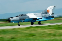 A Romanian air force MiG-21 LanceR fighter aircraft takes off from the flightline during the RoAF's 71st Air Base's air show and open house at Campia Turzii, Romania, July 23, 2016. The aviation demonstration took place during the middle of the U.S. Air Force's 194th Expeditionary Fighter Squadron's six-month long theater security package deployment to Europe in support of Operation Atlantic Resolve, which aims to bolster the U.S.'s continued commitment to the collective security of NATO and dedication to the enduring peace and stability in the region. The unit, comprised of more than 200 CANG Airmen from the 144th Fighter Wing at Fresno ANG Base, Calif., as well as U.S. Air Force Airmen from the 52nd Fighter Wing at Spangdahlem Air Base, Germany, piloted, maintained and supported the deployment of 12 F-15Cs Eagle fighter aircraft throughout nations like Romania, Iceland, the United Kingdom, the Netherlands, Estonia and among others. The F-15Cs took to the skies alongside the 71st AB's MiG-21 fighter aircraft and Puma helicopters for both the airshow, the second engagement of its kind at Campia Turzii under Operation Atlantic Resolve, and the bilateral flight training, also known as Dacian Eagle 2016. (U.S. Air Force photo by Staff Sgt. Joe W. McFadden/Released)