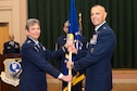 Maj. Gen. Bradley Spacy receives the unit flag from Gen. Ellen Pawlikowski, commander of Air Force Materiel Command, to become commander of the Air Force Installation and Mission Support Center July 22 in a ceremony at the Gateway Club, Joint Base San Antonio-Lackland, Texas. (U.S. Air Force Photo by Staff Sgt. Marissa Garner)