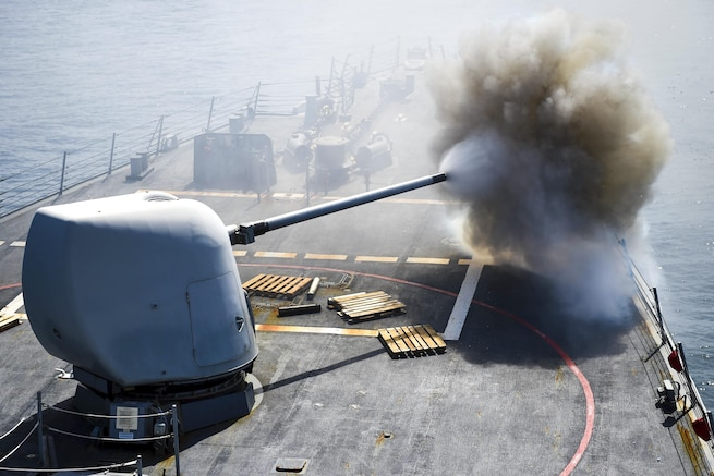 USS Stethem crew members fire an MK 45 5-inch lightweight gun at a surface target during Cooperation Afloat Readiness and Training Singapore 2016, an annual maritime exercise between the United States and nine partner nations, in the South China Sea, July 24, 2016. Navy photo by Petty Officer 1st Class John Pearl