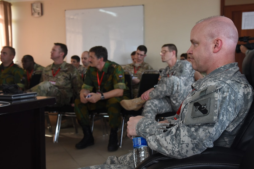 DAR ES SALAAM, Tanzania - U.S. Army Lt. Col. Andrew Rish, 75th Training Command and Eastern Accord 2016 after action report and evaluation coordinator, attends an after action report meeting at the end of the command post exercise, July 21, 2016, at the Tanzanian Peacekeeping Training Centre, in Dar es Salaam, Tanzania. EA16 is an annual, combined, joint military exercise that brings together partner nations to practice and demonstrate proficiency in conducting peacekeeping operations. (U.S. Air Force photo by Staff Sgt. Tiffany DeNault)