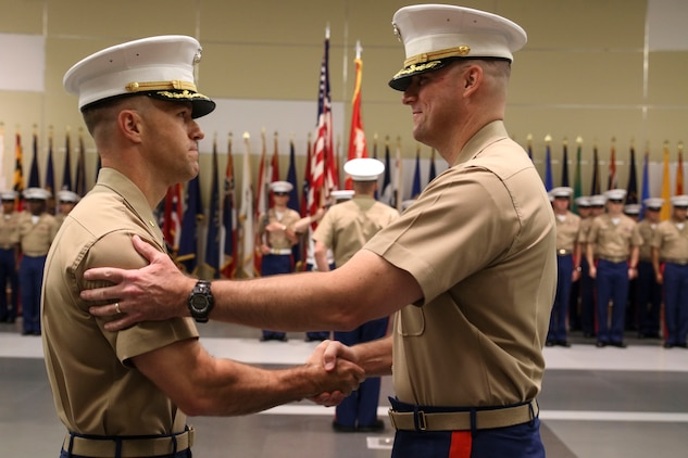 U.S. Marine Corps Maj. Paul B. Bock, right, shakes hands with U.S. Marine Corps Maj. Luke A. Sauber following the passing of the organizational colors during Recruiting Station Frederick's change of command ceremony June 28, 2016 at Fort Detrick. The passing of the colors signifies a formal transfer of authority and responsibility from one commanding officer to another. Bock is the outgoing commanding officer of the recruiting station, while Sauber is the incoming commanding officer.
