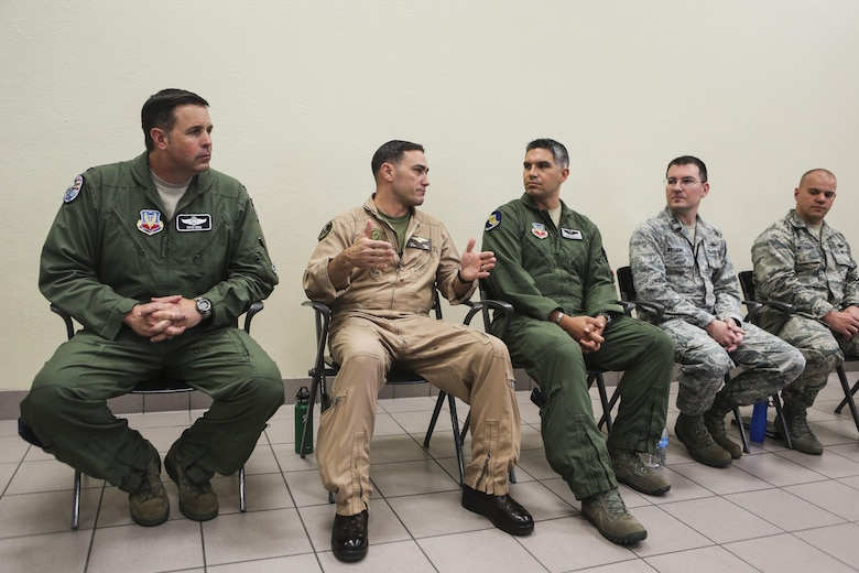 Lt. Col. J.T. Bardo, second from left, commanding officer of Marine Fighter Attack Squadron (VMFA) 121, answers questions about the F-35B Lightning II participating in exercise Red Flag 16-3 at Nellis Air Force Base, Nev., July 20. This is the first time that the fifth generation fighter has participated in the multiservice air-to-air combat training exercise. (U.S. Marine Corps photo by Lance Cpl. Harley Robinson/Released)