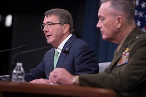 Defense Secretary Ash Carter, left, and Marine Corps Gen. Joe Dunford, chairman of the Joint Chiefs of Staff, speak with reporters at the Pentagon, July 25, 2016. DoD photo by Navy Petty Officer 1st Class Tim D. Godbee