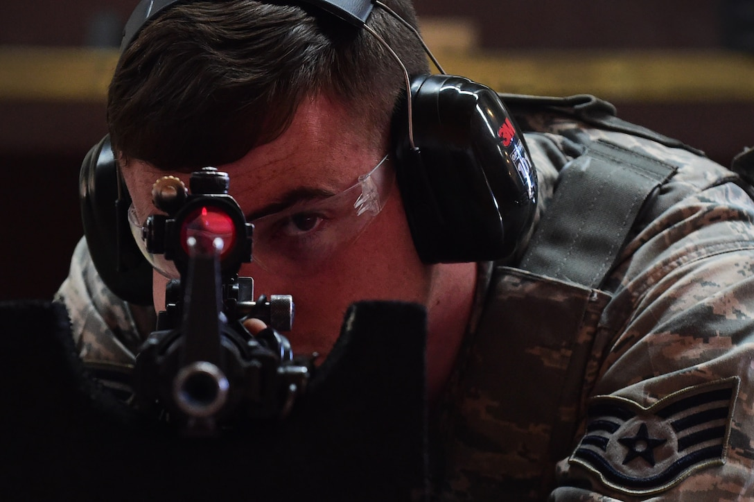 Staff Sgt. David Leonard, 460th Space Wing Security Forces Squadron flight chief, aims an M-4 carbine downrange July 19, 2016, at Buckley Air Force Base, Colo.  Senior Airman, Kari Gardner, Combat Arms Training and Maintenance official, verified all weapons were safe: selector on safe, chamber open with no ammo and no magazine in the magazine well. The member laid in the prone position, looked downrange with his weapon and his ammo was not accessible at any point during this photo opportunity. (U.S. Air Force photo by Airman 1st Class Gabrielle Spradling/Released)