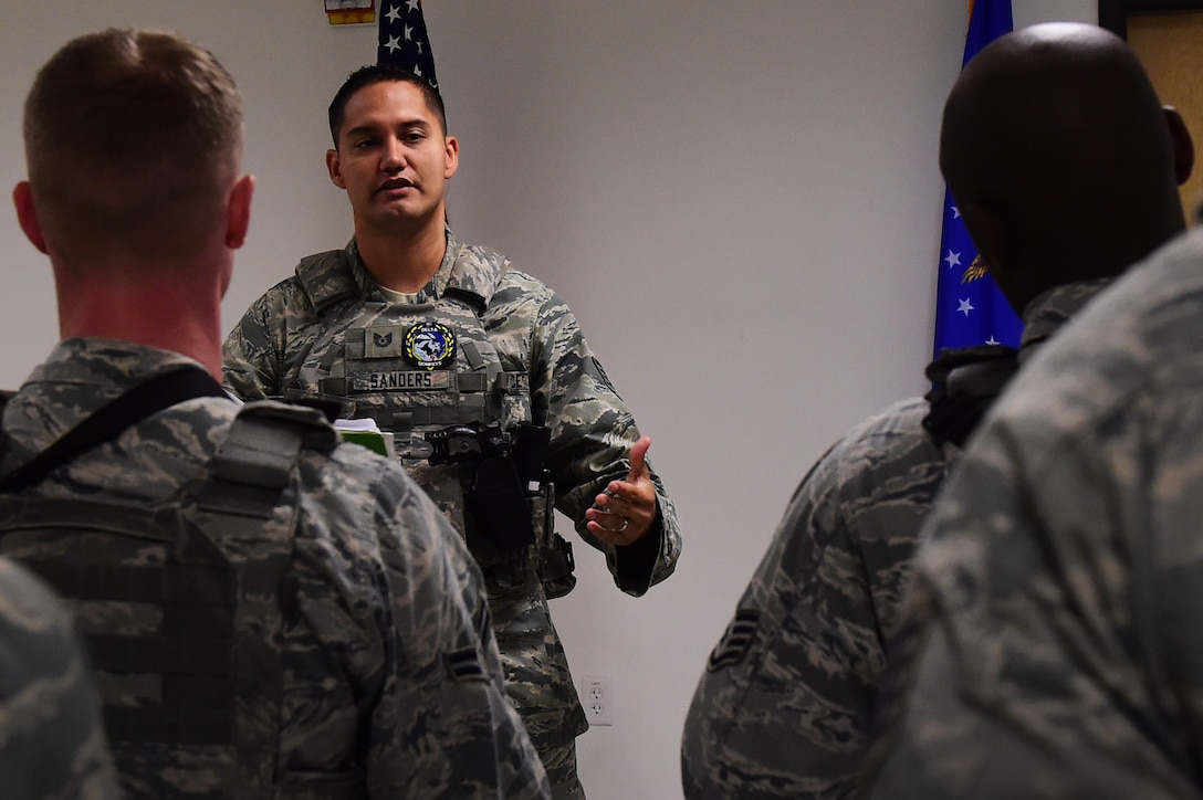 Tech. Sgt. Daniel Sanders, 460th Space Wing Security Forces Squadron flight chief, speaks to fellow defenders during a shift change July 19, 2016, at Buckley Air Force Base, Colo. The breakdown of what has happened since their last shift helps defenders prepare for situations that may come up and also provides supervision to the opportunity to check on their Airmen. (U.S. Air Force photo by Airman 1st Class Gabrielle Spradling/Released)