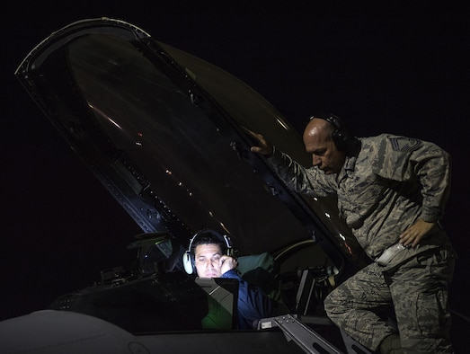"From left, Staff Sgt. Erick Vega, an avionics specialist with the 555th Fighter Squadron out of Aviano Air Base, Italy, attempts to figure out why the space systems on his F-16 Fighting Falcon aren't working correctly, while Chief Master Sgt. Tony Russell, a Red Flag Inspector General evaluator, observers. Airmen from the 527th Space Aggressor Squadron attempt to challenge Red Flag participants by posing attacks on space assets, simulating a potential attack by the enemy. ""We challenge space forces to get better. And they do,"" said Capt. Brian Goodman, 527th SAG.  (U.S. Air Force photo/Tech. Sgt. David Salanitri)"