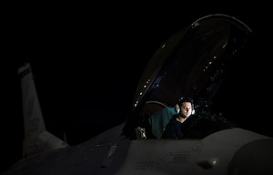Staff Sgt. Erick Vega, an avionics specialist with the 555th Fighter Squadron out of Aviano Air Base, Italy, attempts to determine if his equipment is failing, or if the space systems aboard the F-16 Fighting Falcon is being attacked by simulated enemy forces through space warfare during exercise Red Flag at Nellis Air Force Base, Nevada, July 21, 2016. Red Flag 16-3 is aimed at teaching service members how to integrate air, space and cyberspace elements. (U.S. Air Force photo/Tech. Sgt. David Salanitri)