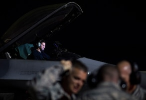 "From the left, Staff Sgt. Erick Vega, an avionics specialist with the 555th Fighter Squadron out of Aviano Air Base, Italy, shows a look of frustration nearly an hour after encountering degraded space operations to his F-16 Fighting Falcon on Nellis Air Force Base, Nevada July 21, 2016 during exercise Red Flag. ""During the exercise, they see the enemy effects. They can apply what they learned from us and overcome what we are doing,"" said Senior Master Sgt. Thomas Arns, 527 Space Aggressor Squadron (U.S. Air Force photo/Tech. Sgt. David Salanitri)"