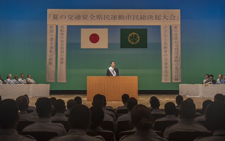 Kazumasa Taneichi, the mayor of Misawa City, speaks to an audience during the 24th Annual Traffic Safety Day in Misawa City, Japan, July 22, 2016. The event beckoned more than 100 service members from Misawa Air Base to help promote traffic safety awareness and the prevention of vehicle accidents. (U.S. Air Force photo by Senior Airman Jordyn Fetter)
