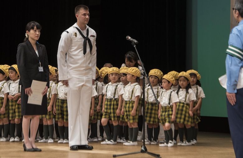 Representatives from the Misawa City Office, Misawa Air Base and the Misawa Daiichi Kindergarten make a safety declaration during the 24th Annual Traffic Safety Day in Misawa City, Japan, July 22, 2016. The representatives stated their commitment to eradicate reckless driving and driving under the influence, along with an overall commitment to the goals of the traffic safety campaign. (U.S. Air Force photo by Senior Airman Jordyn Fetter)