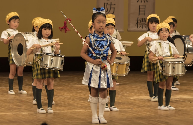 The Misawa Daiichi Kindergarten marching band performs a recital during the 24th Annual Traffic Safety Day in Misawa City, Japan, July, 22, 2016. The demonstration signified the students' dedication to the traffic safety campaign and helped to focus on the prevention of traffic accidents involving children. (U.S. Air Force photo by Senior Airman Jordyn Fetter)