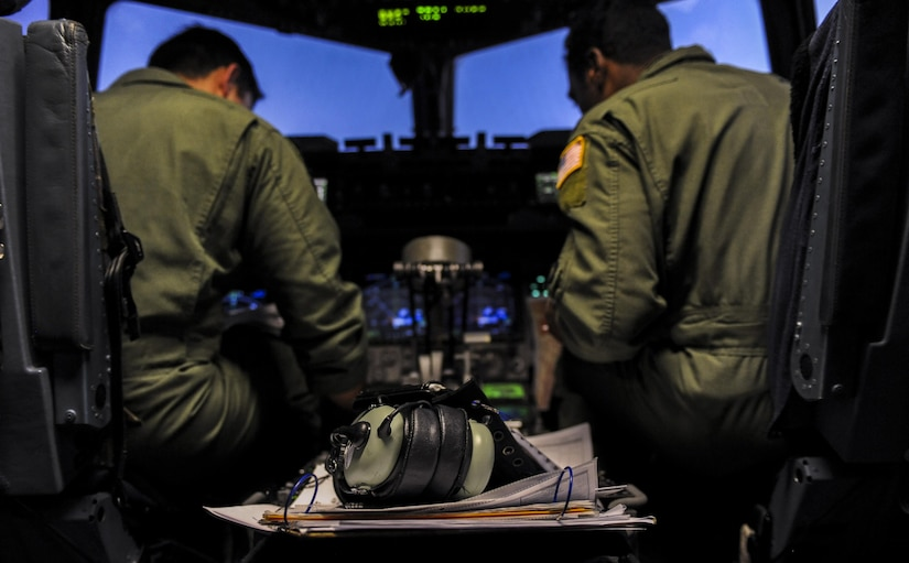 Capts. Scott Levin. Michael Sattes, 437th Airlift Wing, Joint Base Charleston, S.C., pilots, Joint Base Charleston, prepare a C-17 for take-off during Red Flag 16-3 at Nellis Air Force Base, Nev., July 20, 2016. In addition to daytime operations, Red Flag conducts training exercises during hours of darkness to train for low visibility environment. (U.S. Air Force photo by Airman 1st Class Kevin Tanenbaum/Released)