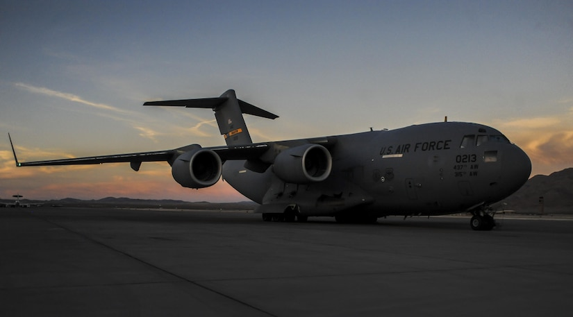 A C-17, assigned to the 437th Airlift Wing, Joint Base Charleston, S.C., sits on the runway before take-off during Red Flag 16-3 at Nellis Air Force Base, Nev., July 20, 2016. Red Flag provides an opportunity for aircrew and military aircraft to enhance their tactical operational skills alongside military aircraft from coalition forces. (U.S. Air Force photo by Airman 1st Class Kevin Tanenbaum/Released)