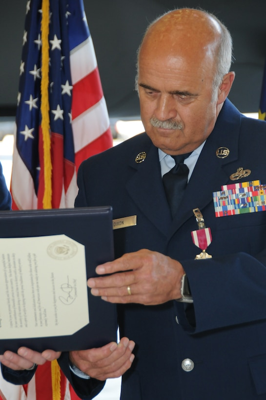 Chief Master Sgt. Bill Dixon reads his Presidential Letter if Appreciation during the retirement ceremony honoring 41 years of military service here at Eielson AFB, Alaska June 29, 2016. The ceremony was attended by more than 200 people and was held in the maintenance bay that was Dixon???s home-away-from-home for almost 20 years. (U.S. Air National Guard photo by Senior Master Sgt. Paul Mann/Released)