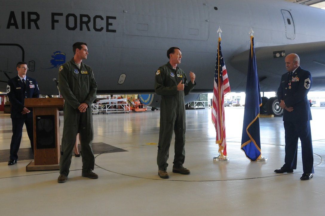 Col. Bryan White, commander of the 168th Operations Group, Alaska Air National Guard, thanks Chief Master Sgt. Bill Dixon for his service and commitment to the mission and people of the interior-Alaska wing where Dixon finished his 41-year career, here at Eielson AFB, Alaska June 29, 2016. White remarked on the amount of hours he and Dixon had flown together in the KC-135 Stratotanker that was parked directly behind them, telling everyone in attendance that Dixon was leaving the unit a much better organization. (U.S. Air National Guard photo by Senior Master Sgt. Paul Mann/Released)
