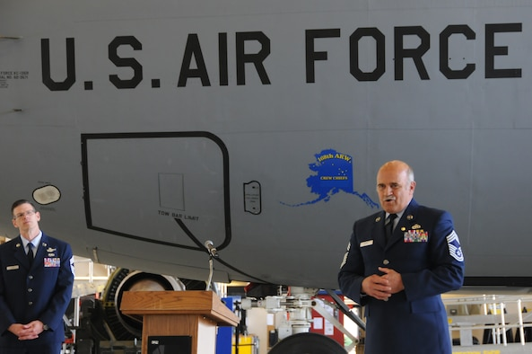 Retired U.S. Air National Guard Chief Master Sgt. Bill Dixon says his final farewells to his friends and co-workers at the interior-Alaska Air Guard wing where he finished 41 years of military service, here at Eielson AFB, Alaska June 29, 2016. The ceremony was attended by more than 200 people and was held in the maintenance bay, which was Dixon???s home-away-from-home for almost 20 years. (U.S. Air National Guard photo by Senior Master Sgt. Paul Mann/Released)