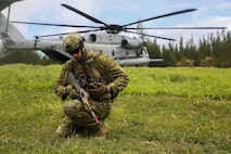 A member of the Australian Army, attached to Golf Company, 2nd Battalion, 3rd Marines, establishes communication after debarking a CH53E Super Stallion helicopter during  Rim of the Pacific 2016.  Twenty-six nations, 49 ships, six submarines, about 200 aircraft, and 25,000 personnel are participating in RIMPAC 16 from June 29 to Aug. 4 in and around the Hawaiian Islands and Southern California. The world's largest international maritime exercise, RIMPAC provides a unique training opportunity while fostering and sustaining cooperative relationships between participants critical to ensuring the safety of sea lanes and security on the world's oceans.