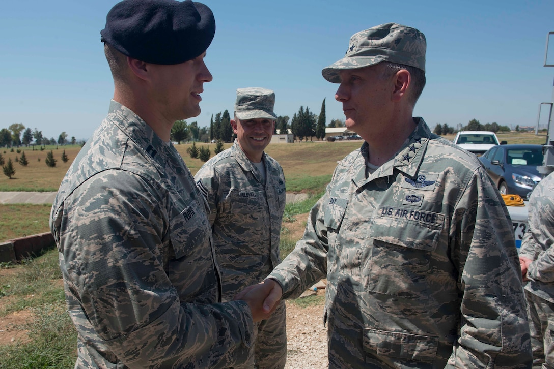 U.S. Air Force Lt. Gen. Timothy Ray, 3rd Air Force commander, coins Capt. Colton Floyd, 39th Security Forces Squadron director of operations, July 25, 2016, at Incirlik Air Base, Turkey. Ray met with 39th Air Base Wing Airmen to recognize them for their recent performance. (U.S. Air Force photo by Senior Airman John Nieves Camacho)