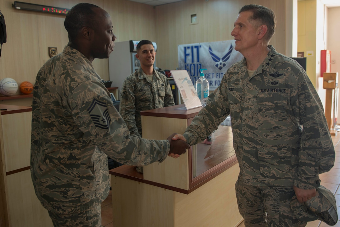 U.S. Air Force Lt. Gen. Timothy Ray, 3rd Air Force commander, greets Senior Master Sgt. Brad Harewood, 39th Force Support Squadron sustainment flight superintendent, July 25, 2016, at Incirlik Air Base, Turkey. Ray visited multiple base facilities to recognize Airmen and see how they contribute to the mission. (U.S. Air Force photo by Senior Airman John Nieves Camacho)