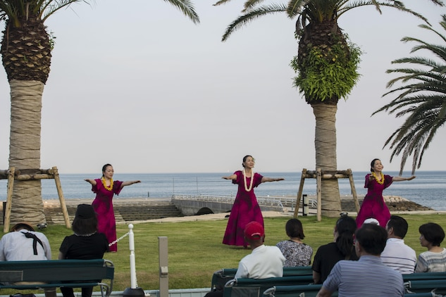 Hula dancers perform for the residents of Marine Corps Air Station Iwakuni and Oshima Islanders during the U.S. – Japan Luau Party on Oshima Island, Japan, July 23, 2016. Marines were able to experience a new part of Japan while celebrating the island's history and friendship with U.S. (U.S. Marine Corps photo by Cpl. Nathan Wicks)