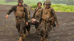 U.S. Marines with Fuels platoon and Headquarters and Service Company, Marine Wing Support Squadron 171 stationed at Marine Corps Air Station Iwakuni, Japan, carry a simulated casualty to an evacuation point while conducting company level training during exercise Eagle Wrath 2016 at Combined Arms Training Center Camp Fuji, July 21, 2016.  MWSS-171 conducts this exercise once a year in order to train all the Marines within the squadron, enhance their technical skills, field experience and military occupational specialty capability. During this training, the company commanders have the opportunity to train their personnel and prepare for the final culminating event where Marines will construct and defend a landing zone and refueling point.