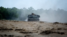 An M1A1 Abrams battle tank with Fox Company, 4th Tank Battalion, drives to an objective as a part of a combined arms breaching exercise at Marine Corps Base Camp Lejeune N.C., July 22, 2016. Elements from a Marine engineer unit worked with 4th Tanks to clear obstacles to make way for the infantry.
